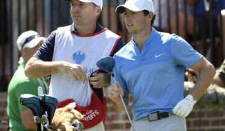 "In this Aug. 28, 2016 photo, Rory McIlroy of Northern Ireland, right,  and his caddy, J. P. Fitzgerald look down the fairway before McIlroy tees off from the first hole during the final round of The Barclays golf tournament in Farmingdale, N.Y..  McIlroy didn't have to check his bank account to know that his FedEx Cup bonus had been deposited. His caddie, J.P. Fitzgerald, informed him with a text message that a 'tsunami' had hit his account. McIlroy paid him a bonus of just over $1 million.  ""I think his words were, 'A tsunami just hit my bank account, so thank you very much,'"" McIlroy said Wednesday, Oct. 26, 2016,  on the eve of the HSBC Champions. (AP Photo/Kathy Kmonicek)"
