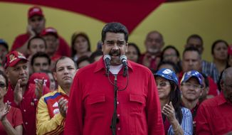 """Venezuela's President Nicolas Maduro speaks during a political rally against the Congress in Caracas, Venezuela, Tuesday, Oct. 25, 2016. After the government suspended a recall referendum seeking Maduro's removal last week, the opposition-controlled congress began debating his """"constitutional situation."""" Lawmakers vow to present evidence that Maduro a dual Colombian citizen and therefore constitutionally ineligible to hold Venezuela's highest office. (AP Photo/Alejandro Cegarra)"""