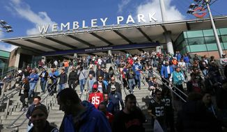 Supporters leave Wembley Park tube station in London as they make their way to the NFL game between the Indianapolis Colts and Jacksonville Jaguars at Wembley Stadium on Oct. 2. (Associated Press)