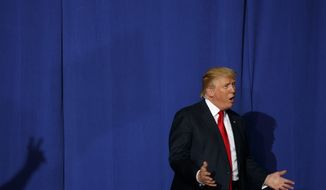 Republican presidential candidate Donald Trump arrives to speak to a campaign rally, Thursday, Oct. 27, 2016, in Geneva, Ohio. (AP Photo/ Evan Vucci)