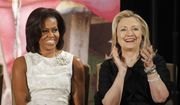 In this March 8, 2012, file photo, then-Secretary of State Hillary Clinton and first lady Michelle Obama attend the 2012 International Women of Courage Awards at the State Department in Washington. Clinton and Obama are slated to campaign together for the first time at a rally in Winston-Salem, North Carolina on Oct. 27, 2016. The event will bring together two women who are a study in contrasts. Clinton is perhaps one of the least traditional first ladies in modern history, while Obama has fully embraced tradition. (AP Photo/Charles Dharapak, File)