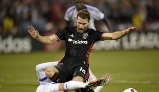 D.C. United forward Patrick Mullins (16) goes down against Montreal Impact defender Laurent Ciman, left, during the second half of an MLS playoff soccer match, Thursday, Oct. 27, 2016, in Washington. The Impact won 4-2. (AP Photo/Nick Wass)