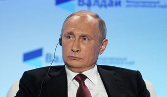 Russian President Vladimir Putin attends a meeting of the Valdai International Discussion Club in Sochi, Russia, Thursday, Oct. 27, 2016. President Vladimir Putin says the claims of Russia's interference in the U.S. presidential election are designed to distract public attention from real issues. (Mikhail Klimentyev/Sputnik, Kremlin Pool Photo via AP)