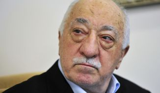 In this July 2016 file photo, Islamic cleric Fethullah Gulen speaks to members of the media at his compound, in Saylorsburg, Pa. Turkeys justice minister on Thursday, Oct. 27, 2016, pressed the U.S. to extradite Gulen who he accuses of orchestrating the July failed coup attempt or risk seriously harming relations between the two countries.  (AP Photo/Chris Post, File)