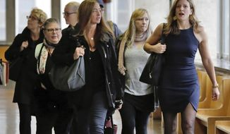 FILE- In this Oct. 21, 2016 file photo, a group of former jurors in the previous trial of Pedro Hernandez, including Cynthia Cueto, foreground left, and Jennifer O'Connor, right, arrive to observe his retrial. Former jurors and alternates were in the courtroom audience when a retrial opened last week in the 1979 disappearance of Etan Patz. Some ex-jurors have shown up for even routine court hearings, and a handful plan to attend as much of the retrial as they can. (AP Photo/Richard Drew, File)