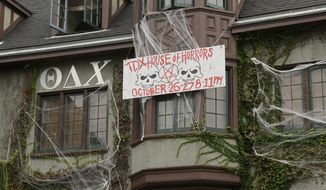 A sign hangs outside the decorated Theta Delta Chi fraternity near the University of California, Berkeley campus Thursday, Oct. 27, 2016, in Berkeley, Calif. UC Berkeley's fraternity and sorority parties are back on this weekend, after a weeklong self-imposed ban. But there will be new guidelines that members say are aimed at eliminating sexual assaults.(AP Photo/Eric Risberg)
