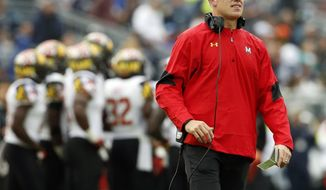 FILE - In this Oct. 8, 2016, file photo, Maryland head coach DJ Durkin watches from the sidelines against Penn State during the second half of an NCAA college football game in State College, Pa. After going 3-9 last season and winning only one Big Ten game, Maryland now needs only one victory to become bowl eligible. (AP Photo/Chris Knight, File)