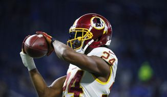In this photo taken Oct. 23, 2016, Washington Redskins cornerback Josh Norman makes a catch during pre game of an NFL football game against the Detroit Lions in Detroit. Norman and Washington Redskins tight end Jordan Reed have been cleared to fly with the team to London for its game against the Cincinnati Bengals after dealing with concussions. (AP Photo/Paul Sancya)