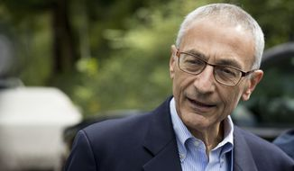 In this Oct. 5, 2016, file photo, Hillary Clinton's campaign manager John Podesta speaks to members of the media outside Clinton's home in Washington. (AP Photo/Andrew Harnik, File)