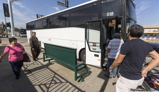 In this Wednesday, Oct. 26, 2016, photo, casino-bound travelers board a tour bus in Los Angeles. Bus tours have been a fixture across the American landscape for years, shuttling gamblers from cities to rural places where casinos are located, particularly in California where tribal operations are often hours away. (AP Photo/Damian Dovarganes)