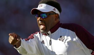 FILE - In this Saturday, Oct. 22, 2016, file phot, Texas A&M head coach Kevin Sumlin yells plays to his team during the first half of an NCAA college football game Alabama in Tuscaloosa, Ala. No. 9 Texas A&M gets a break from SEC play and a chance to bounce back after last week's loss to top-ranked Alabama when the Aggies host New Mexico State on Saturday.(AP Photo/Brynn Anderson, File)