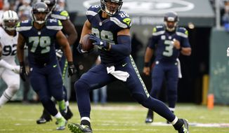 FILE - In this Oct. 2, 2016, file photo, Seattle Seahawks tight end Jimmy Graham (88) runs for yards after catch during the second half of an NFL football game against the New York Jets in East Rutherford, N.J. Graham is headed back to New Orleans this week with the Seahawks. Graham was a star with the Saints before the surprising trade that sent him to Seattle before the start of last season. (AP Photo/Kathy Willens, File)