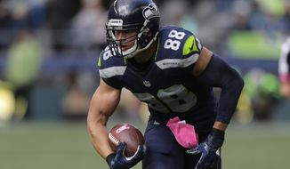 FILE - In this Oct. 16, 2016, file photo, Seattle Seahawks tight end Jimmy Graham runs the ball after a reception during an NFL football game against the Atlanta Falcons in Seattle. An NFL football game Sunday, Oct. 30, 2016, will mark the first time Graham will play against the New Orleans Saints who drafted him in 2010 and developed him into a star before trading him in 2015 to Seattle for center Max Unger and first-round draft choice. (AP Photo/Stephen Brashear, File)