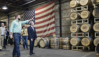 Charlie Nelson, left, shows U.S. Trade Representative Michael Froman around the Nelson's Green Brier Distillery in Nashville, Tenn., on Friday, Oct. 28, 2016. Froman visited the distillery to promote the Trans Pacific Partnership agreement that he said could eliminate duties on exported whiskey of up to 45 percent. (AP Photo/Erik Schelzig)
