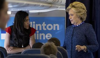 Democratic presidential candidate Hillary Clinton speaks with senior aide Huma Abedin aboard her campaign plane at Westchester County Airport in White Plains, Oct. 28, 2016. The longtime Hillary Clinton aide at the center of a renewed FBI email investigation testified under oath four months ago she never deleted old emails, despite promising in 2013 not to take sensitive files when she left the State Department.  (AP Photo/Andrew Harnik) ** FILE **