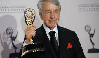 FILE - In this Aug. 21, 2010 file photo, Norman Brokaw poses with the Governor's Award in the press room at the Creative Arts Emmy Awards in Los Angeles.  Brokaw, who ascended from mailroom at the William Morris Agency to become its CEO and represented top talent such as Marilyn Monroe, Clint Eastwood and Bill Cosby, died on Saturday, Oct. 29, 2016, after a long illness. (AP Photo/Chris Pizzello)