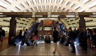 The head of the D.C. Metro rail system said that, in order to eliminate a budget shortfall, fares will be hiked and workers will be faced with layoffs. At the same time, Maryland, Virginia and District governments will have to pay more into the system. (Associated Press) **FILE**