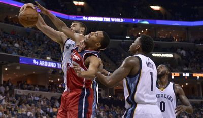 Washington Wizards forward Otto Porter Jr. (22) struggles to shoot between Memphis Grizzlies center Marc Gasol, left, forward Jarell Martin (1), and forward JaMychal Green (0)in the first half of an NBA basketball game Sunday, Oct. 30, 2016, in Memphis, Tenn. (AP Photo/Brandon Dill)