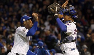 Chicago Cubs relief pitcher Aroldis Chapman, left, celebrates with catcher Willson Contreras after Game 5 of the Major League Baseball World Series against the Cleveland Indians, Sunday, Oct. 30, 2016, in Chicago. The Cubs won 3-2 as the Indians lead the series 3-2. (AP Photo/Nam Y. Huh)