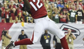 Atlanta Falcons wide receiver Mohamed Sanu (12) makes a touchdown catch against the Green Bay Packers during the second of an NFL football game, Sunday, Oct. 30, 2016, in Atlanta. The Atlanta Falcons won 33-32. (AP Photo/Rainier Ehrhardt)
