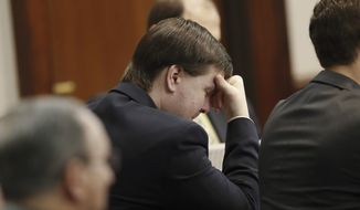 Justin Ross Harris, who is accused of intentionally killing his son in June 2014 by leaving him in a hot car listens as his ex-wife Leanna Taylor testifies during his murder trial Monday, Oct. 31, 2016, in Brunswick, Ga. (AP Photo/John Bazemore, Pool) ** FILE **
