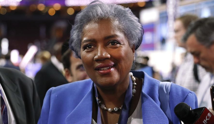 "FILE - In this July 25, 2016 file photo, Donna Brazile, interim chair of the Democratic National Committee, appears on the floor of the Democratic National Convention in Philadelphia. CNN says it is ""completely uncomfortable"" to learn through WikiLeaks that Brazile had contacted the Clinton campaign ahead of time about a question that would be posed during a presidential primary town hall last March in Flint, Mich. CNN announced Monday, Oct. 31, that it had accepted Brazile's resignation as a contributor two weeks ago. Her deal had been suspended in July when she became interim head of the Democratic National Committee. (AP Photo/Paul Sancya, File)"