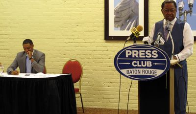 Baton Rouge mayor Kip Holden, right, a Democrat running for a U.S. House seat, speaks to the Press Club of Baton Rouge about the 2nd Congressional District race while Democratic incumbent U.S. Rep. Cedric Richmond listens, on Monday, Oct. 31, 2016, in Baton Rouge, La. (AP Photo/Melinda Deslatte)