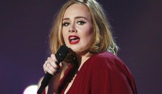 FILE - This Feb. 24, 2016 file photo shows Adele onstage at the Brit Awards 2016 at the 02 Arena in London. Adele opened up  to Vanity Fair about parenting and her struggle with postpartum depression in an issue for the magazine's December 2016 issue. (Photo by Joel Ryan/Invision/AP, File)