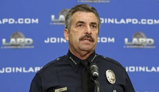FILE - In this Feb. 4, 2014 file photo, Los Angeles Police Chief Charlie Beck speaks at a news conference at LAPD headquarters. The LAPD said in a statement Sunday that Beck fractured his pelvis in an off-road motorcycle accident Saturday, Oct. 29, 2016. Beck was riding in the Tehachapi Mountains north of Los Angeles with friends Saturday when he fell on a rocky trail. Beck was able to ride back to his truck and went to the hospital after driving home. (AP Photo/Reed Saxon, File)