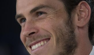 Real Madrid's Gareth Bale smiles during a press conference at the Santiago Bernabeu stadium in Madrid, Spain, Monday Oct. 31, 2016. Bale has agreed to a contract extension with the club that will tie the Wales winger to the European champions through 2022. (AP Photo/Paul White)