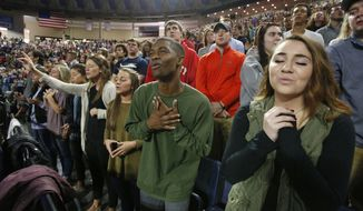 In this Wednesday, Oct. 12, 2016 photo, Liberty University students sing and pray prior to a speech by Republican vice presidential candidate, Indiana Gov. Mike Pence, at Liberty University in Lynchburg, Va. Evangelicals, deeply divided over Republican presidential candidate Donald Trump, are wrestling with what the tumultuous 2016 election will mean for their future. (AP Photo/Steve Helber/File)