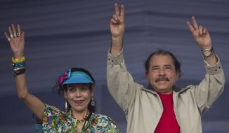 In this July 3, 2016, file photo Nicaragua's President Daniel Ortega, right, and first lady Rosario Murillo, wave to supporters during an event commemorating the 36th anniversary of the Sandinista National Liberation Front withdrawal to Masaya, in Managua, Nicaragua. Murillo, now running as her husband's VP ticket mate in a Nov. 6 election, is seen as a shoo-in and is poised to finally have the title to match her true influence. (AP Photo/Esteban Felix, File)