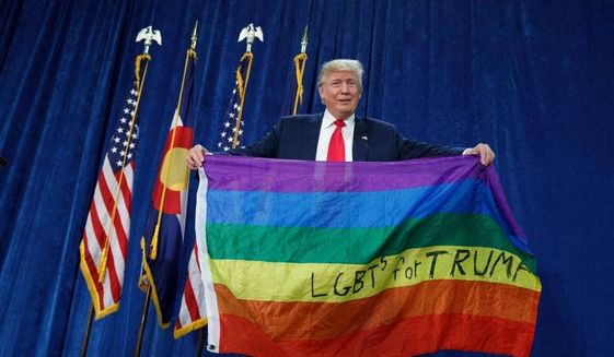 Then-Republican presidential nominee Donald Trump holds a rainbow flag in support of the LGBT community during a rally at the University of Northern Colorado on Oct. 29, 2016. (Colorado Log Cabin Republicans) ** FILE **