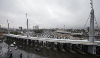 FILE - In this Dec. 3, 2014, file photo, cars wait to enter the United States from Tijuana, Mexico, through the San Ysidro port of entry in San Diego. An increasing number of people from far-flung corners of the world quietly have tried to sneak into the United States among the hundreds of thousands of other, mostly Latin American migrants caught at the Mexican border in 2015, according to arrest data from the Homeland Security Department. (AP Photo/Gregory Bull, File)