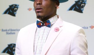 FILE - In this Sunday, Oct. 30, 2016, file photo, Carolina Panthers' Cam Newton speaks to the media after an NFL football game against the Arizona Cardinals, in Charlotte, N.C. Newton blasted NFL officiating following Sunday's game against the  Cardinals after taking a shot to his lower right leg from defensive tackle Calais Campbell as he was releasing the ball. (AP Photo/Bob Leverone, File)