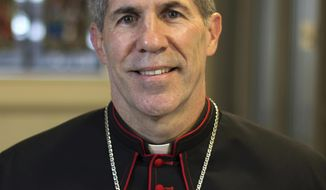 In this Monday, Oct. 31, 2016 photo provided by Archdiocese of Detroit, Bishop Michael Jude Byrnes poses for a photo at the Archdiocese of Detroit Chancery in Detroit. Pope Francis on Monday named Byrnes, the auxiliary bishop of Detroit, as coadjutor bishop of the Guam archdiocese. Coadjutors have succession rights when bishops resign, retire or are removed. (Tim Hinkle/Archdiocese of Detroit via AP)