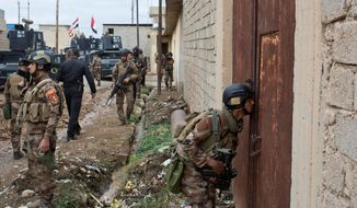 Iraqi special operations troops searched a compound in Gogjali, an eastern district of Mosul, to clear out any remaining Islamic State militants on Wednesday. They killed at least eight. (Associated Press)
