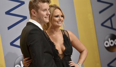 Anderson East, left, and Miranda Lambert arrive at the 50th annual CMA Awards at the Bridgestone Arena on Wednesday, Nov. 2, 2016, in Nashville, Tenn. (Photo by Evan Agostini/Invision/AP)