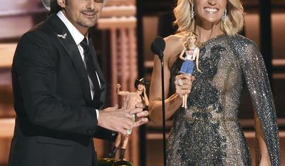 Hosts Brad Paisley, left, and Carrie Underwood speak at the 50th annual CMA Awards at the Bridgestone Arena on Wednesday, Nov. 2, 2016, in Nashville, Tenn. (Photo by Charles Sykes/Invision/AP)