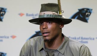 Carolina Panthers' Cam Newton speaks to the media during a news conference in Charlotte, N.C., Wednesday, Nov. 2, 2016. Newton spoke briefly about meeting with NFL commissioner Roger Goodell after complaining that he didn't feel officials were protecting him in the pocket. (AP Photo/Chuck Burton)