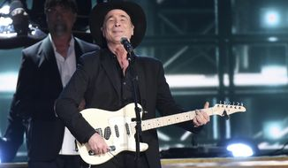 "Clint Black performs ""Killin' Time"" during the 50th annual CMA Awards at the Bridgestone Arena on Wednesday, Nov. 2, 2016, in Nashville, Tenn. (Photo by Charles Sykes/Invision/AP)"