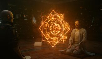 """This image released by Disney shows Tilda Swinton, left, and Benedict Cumberbatch in a scene from Marvel's """"Doctor Strange."""" (Disney/Marvel via AP)"""