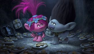 "This image released by Dreamworks Animation shows characters Poppy, left, voiced by Anna Kendrick, and Branch, voiced by Justin Timberlake in a scene from ""Trolls."" (DreamWorks Animation via AP)"