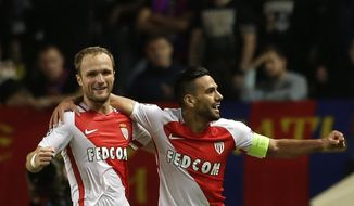 Monaco's Radamel Falcao, right, celebrates witth teammate Monaco's Valere Germain after scoring his team's third goal during their Champions League Group E soccer match between Monaco and CSKA at the Louis II stadium in Monaco, Wednesday Nov. 2, 2016. (AP Photo/Claude Paris)