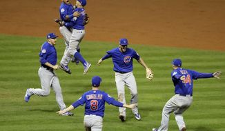 The Chicago Cubs celebrate after Game 7 of the World Series against the Cleveland Indians Thursday in Cleveland. The Cubs won 8-7 in 10 innings to win the series 4-3. (Associated Press)