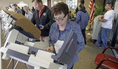 Elaine Davis votes during early voting for the 2016 general election, Thursday, Nov. 3, 2016, at the Salt Lake County Government Center in Salt Lake City.(AP Photo/Rick Bowmer)