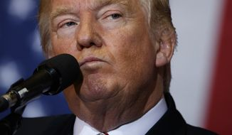 Republican presidential candidate Donald Trump pauses while speaking during a campaign rally at the Jacksonville Equestrian Center, Thursday, Nov. 3, 2016, in Jacksonville, Fla. (AP Photo/ Evan Vucci)