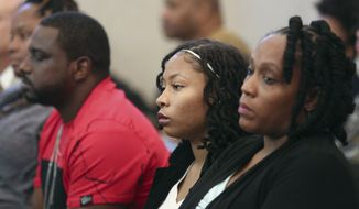 From left, Sam Dubose's, brother Aubrey DuBose, Sam's daughter Chyna-Shakura DuBose-Reid, and Sam's fiancee DaShonda Reid, listen to a Cincinnati police interview of Ray Tensing, at the Hamilton County Courthouse, Thursday, Nov. 3, 2016, in Cincinnati. Tensing, a former University of Cincinnati police officer, is charged with fatally shooting Sam DuBose during a routine traffic stop in July 2015. (Cara Owsley/The Cincinnati Enquirer via AP, Pool)