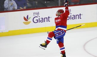 Washington Capitals left wing Alex Ovechkin, from Russia, celebrates his winning goal in the overtime period of an NHL hockey game against Winnipeg Jets, Thursday, Nov. 3, 2016, in Washington. (AP Photo/Alex Brandon)