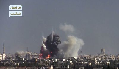 This frame grab from video provided by this militant video by Fatah al-Sham Front that is consistent with independent AP reporting, shows flames and smoke rise from a suicide bomb attacked Syrian government forces positions, in western Aleppo, Syria, Thursday, Nov. 3, 2016. The Britain-based Syrian Observatory for Human Rights, which monitors the conflict through local contacts, reported that rebels attacked government positions with two explosives-laden vehicles. Syrian rebels launched a fresh wave of attacks on western districts of Aleppo Thursday as airstrikes on a rebel-held village south of the contested city killed civilians, activists said. (militant video by Fatah al-Sham Front, via AP)